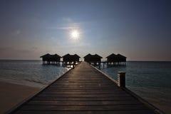 Puesta del sol en contraluz del watervilla Fotos de archivo libres de regalías