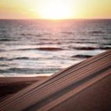 Puesta del sol en costa atlántica francesa Imagenes de archivo