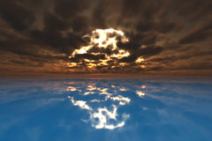 Puesta del sol en el agua azul Fotografía de archivo
