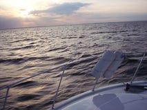 Puesta del sol en el barco Imagen de archivo libre de regalías
