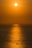 Puesta del sol en el cabo Uluwatu, Bali Fotos de archivo libres de regalías