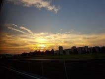 Puesta del sol en el camino Imágenes de archivo libres de regalías