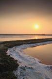 Puesta del sol en el campo de la sal Imagen de archivo