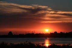 Puesta del sol en el delta de Danubio Foto de archivo libre de regalías