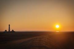 Puesta del sol en el dique de Westerhever fotos de archivo