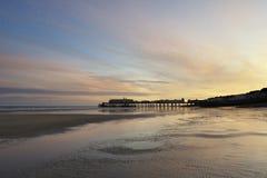 Puesta del sol en el embarcadero de Hastings   Fotos de archivo libres de regalías