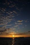 Puesta del sol en el embarcadero de la pesca Imagen de archivo libre de regalías
