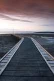 Puesta del sol en el embarcadero en la bahía de Morecambe Imagen de archivo libre de regalías