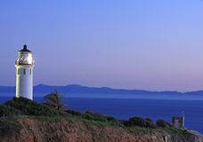 Puesta del sol en el faro de Vicente de la punta Foto de archivo libre de regalías