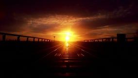 Puesta del sol en el ferrocarril Foto de archivo libre de regalías
