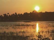 Puesta del sol en el God& x27; s posee el país, Kerala La India Imagen de archivo