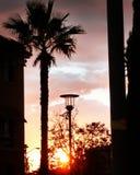 Puesta del sol en el hogar del paseo Fotografía de archivo libre de regalías