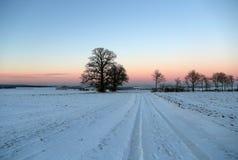 Puesta del sol en el invierno Fotos de archivo libres de regalías