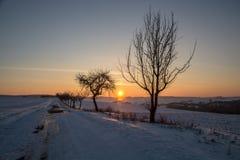 Puesta del sol en el invierno Imagenes de archivo