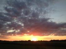 Puesta del sol en el lado del país Imagen de archivo