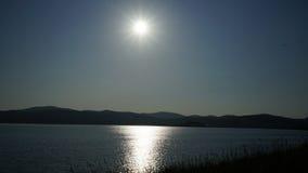 Puesta del sol en el lago Imágenes de archivo libres de regalías