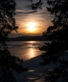 Puesta del sol en el lago del hielo Foto de archivo
