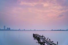 Puesta del sol en el lago del oeste Fotos de archivo libres de regalías