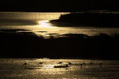 Puesta del sol en el lago en Israel Imagen de archivo