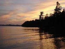 Puesta del sol en el lago Raquette fotos de archivo