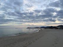 Puesta del sol en el mar Foto de archivo libre de regalías