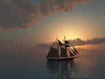 Puesta del sol en el mar con la nave del Schooner Fotos de archivo