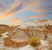 Puesta del sol en el paisaje septentrional de los Badlands Fotografía de archivo libre de regalías