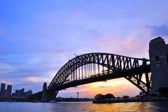 Puesta del sol en el puente de puerto de Sydney Fotografía de archivo