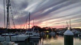 Puesta del sol en el puerto deportivo Imágenes de archivo libres de regalías