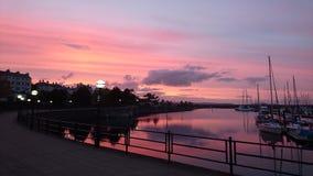 Puesta del sol en el puerto/el puerto Foto de archivo