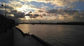 Puesta del sol en el río Imagen de archivo