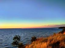 Puesta del sol en el río de Dnieper Foto de archivo