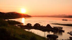 Puesta del sol en el río Mekong Imagen de archivo libre de regalías