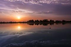 Puesta del sol en el río Mincio Fotografía de archivo