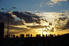 Puesta del sol en el rompeolas de Cottesloe Imágenes de archivo libres de regalías