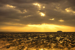 Puesta del sol en el Tg. Playa de Aru Foto de archivo libre de regalías