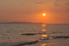 Puesta del sol en Follonica, Italia Fotos de archivo libres de regalías