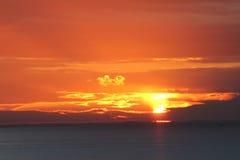 Puesta del sol en Hunstanton Norfolk imagenes de archivo