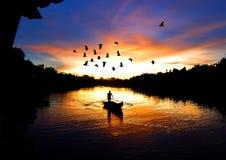 Puesta del sol en Kampung Kuantan Foto de archivo libre de regalías