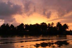 Puesta del sol en Kerala, la India Foto de archivo libre de regalías