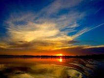 Puesta del sol en la cadena de los lagos en asilo del invierno Foto de archivo libre de regalías