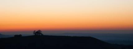 Puesta del sol en la colina de Coombe en las colinas de Chiltern Foto de archivo