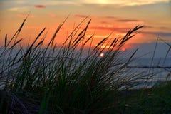 Puesta del sol en la costa báltica Fotos de archivo