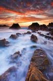 Puesta del sol en la costa oeste de Guernesey Fotos de archivo libres de regalías