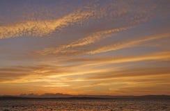 Puesta del sol en la costa peruana Imagenes de archivo
