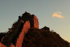 Puesta del sol en la Gran Muralla de China Imagen de archivo