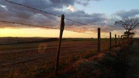 Puesta del sol en la granja, Paraná, el Brasil foto de archivo