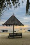 Puesta del sol en la isla de Mabul imagen de archivo libre de regalías