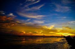 Puesta del sol en la isla de Pari Fotos de archivo libres de regalías