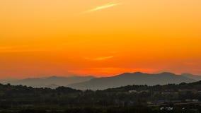 Puesta del sol en la montaña Fotografía de archivo libre de regalías